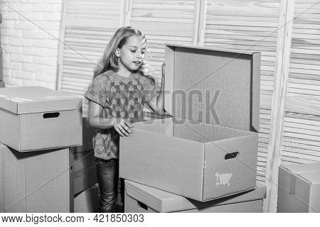 Happy Little Girl. Purchase Of New Habitation. Happy Child Cardboard Box. Moving Concept. New Apartm