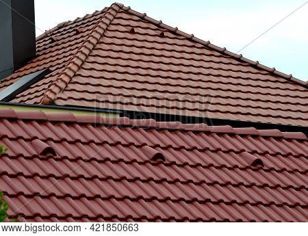 Roof Tile Or Painted Concrete, Orange With Ventilation And Top Row On The Ridge. Side View In Contra