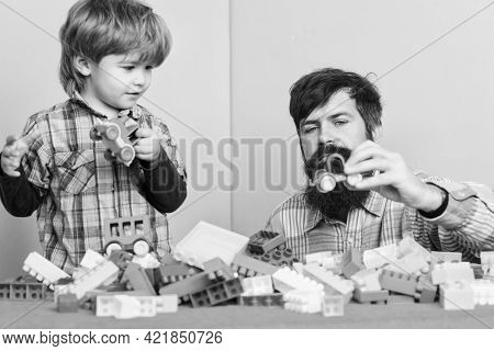 Child Development And Upbringing. Father And Son Have Fun. Bearded Hipster And Boy Play Together. Da