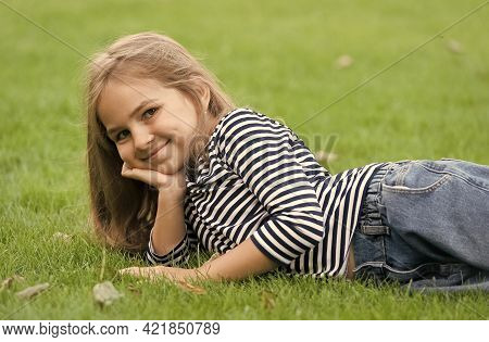 Enjoy Summer Safely. Happy Kid Relax On Green Grass. Fashion Summer Style. Beauty Salon. Natural Cos