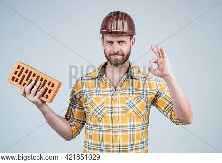 Professional Bricklayer Show Ok Gesture. Builder Engineer. Labor Or Workers Day.