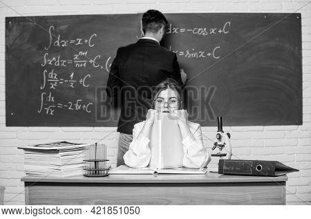 Stem Faculty. Man Writing On Chalkboard Math Formulas. Teaching In University. High School. Universi