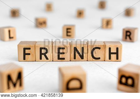 French - Word From Wooden Blocks With Letters, French Language Concept, Random Letters Around White