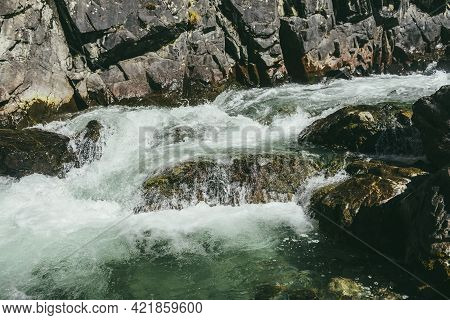 Atmospheric Mountain Landscape With Turbulent Mountain River Among Rocks With Moss Near Rocky Wall I