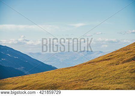 Minimalist Autumn Landscape With Diagonal Of Sunlit Orange Mountainside On Background Of Mountains S