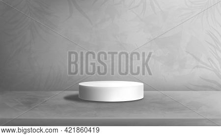 White Podium On Concrete Floor In Studio Room With Palm Leaves On Gray Cement Wall Texture Backgroun
