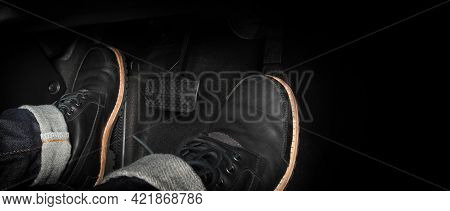 Foot Pressing Foot Pedal Of A Car To Drive. Accelerator And Brake Pedal In A Car.