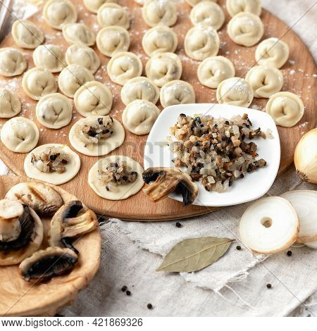 Dumplings Stuffed With Mushrooms And Onions. Cooking Process. Filling On Rolling Raw Dough Circles A