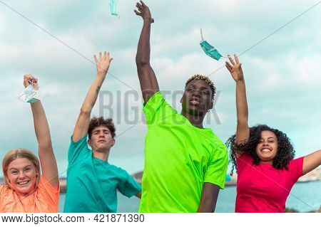 Four Happy Teenager  Outdoors Without Medical Mask With Opened Arms Looking At The Camera After Quar