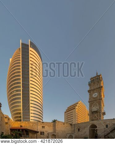 Haifa, Israel - May 25, 2021: Sunset View Of The Minaret And Clock Tower Of The Al Jarina Mosque (ju