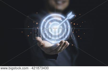 Businessman Holding Virtual Blue Dartboard With Arrow ,business Achievement Objective Target Concept