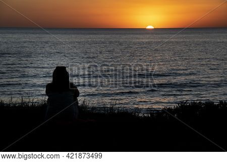 Person Silhouette Watching Sunset