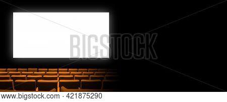 Cinema Movie Theatre With Orange Velvet Seats And A Blank White Screen. Copy Space Background. Horiz