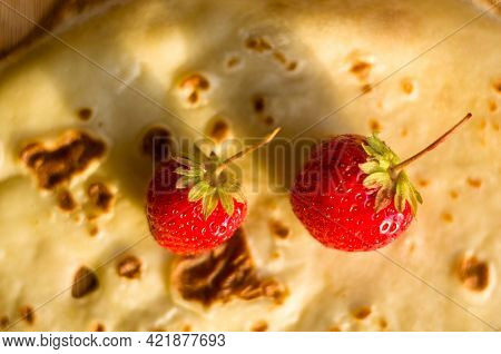 Ripe Fresh Strawberries On A Thin Pancake In A Red Plate, Close-up.