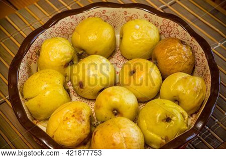 Baked Apples With Cinnamon In A Ceramic Bowl On A Bamboo Mat