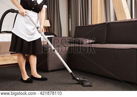 Clean House Is Key For Productivity. Cropped Shot Of Housemaid During Work, Cleaning Living Room Wit