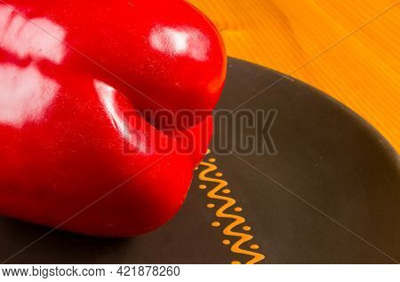 A Freshest Red Paprika, Bell Pepper In Ceramic Plate