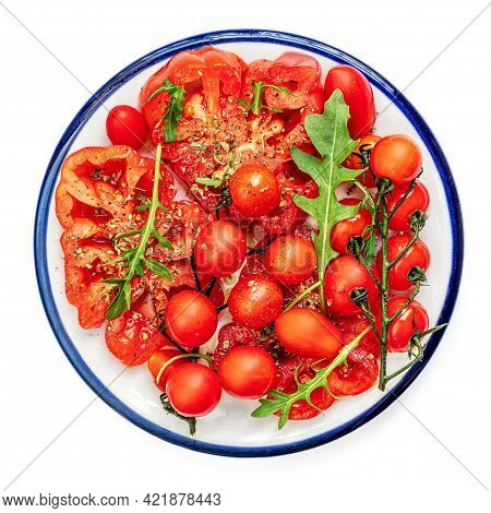 Ripe Fresh Tomatoes Salad With Herbs, Spices On A Plate  Isolated On White Background. Flat Lay. Foo