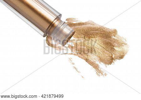 Spilled Golden Liquid Eyeshadows Isolated Over White