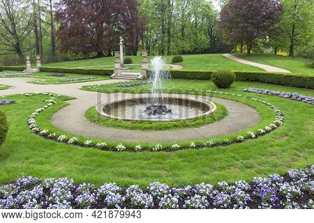 Lancut, Poland -may 5, 2013: Italian Garden In Front Of 16th Century Baroque Lancut Castle, Former P
