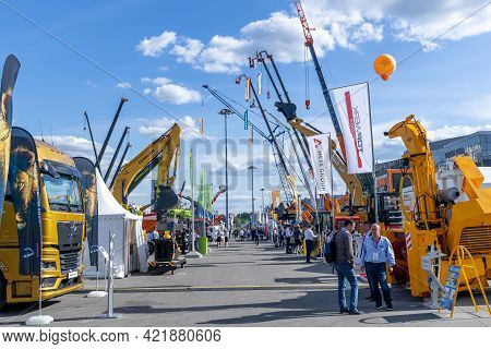 Construction Machinery And Equipment Fair Bauma Cct Russia. Outdoor Exhibition With Trucks, Cranes,