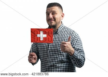 White Guy Holding A Flag Of Switzerland And Shows The Class By Hand Isolated On A White Background.