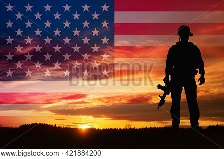 Silhouette Of A Soldiers Against The Sunrise And Flag Usa. Concept - Protection, Patriotism, Honor.