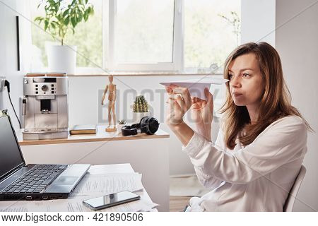 Woman Procrastinate At Workplace. Freelancer On Remote Work At Home Office. Unmotivated Tired Woman