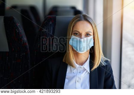 Subway commuter woman in mask on public transport.