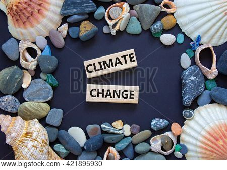 Climate Change Symbol. Wooden Blocks With Words 'climate Change' On Beautiful Black Background. Sea