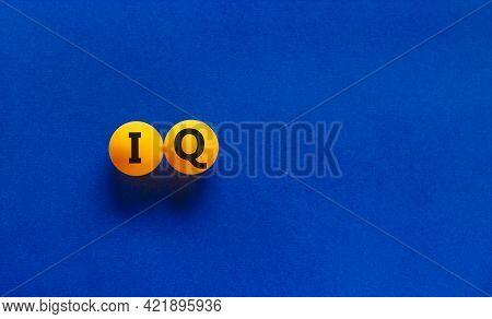 Iq, Intelligence Quotient Symbol. Orange Table Tennis Balls With Words 'iq, Intelligence Quotient'.