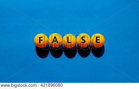 False Symbol. Orange Table Tennis Balls With The Words 'false'. Beautiful Blue Background, Copy Spac