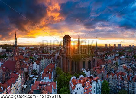 Amazing architecture of the main city in Gdansk at sunset, Poland. Aerial view of the St. Mary Basilica and  Main Town Hall.