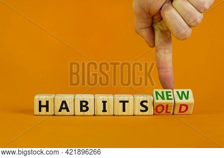 New Or Old Habits Symbol. Businessman Turns Cubes And Changes Words 'old Habits' To 'new Habits'. Be