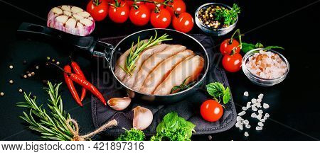 Top View With Copy Space.chicken Fillet In A Skillet With Spices And Vegetables On A Dark Background