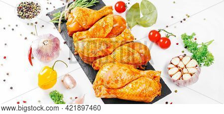 Cooking Chicken Drumsticks.raw Chicken Legs In A Marinade With Rosemary And Pepper.ogranic Food And