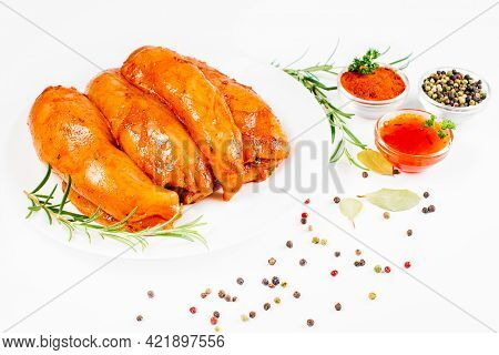 Marinated Chicken Breast With Spices And Rosemary. Raw Meat In The Marinade. Sottilissime Raw Fillet