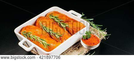 Chicken Fillet With Rosemary Branch In A White Oven Baking Bowl.