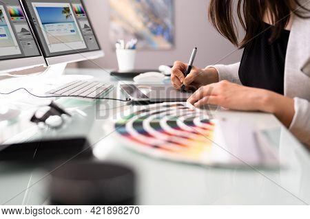 Graphic Web Designer Using Multiple Monitors Desktop Computer