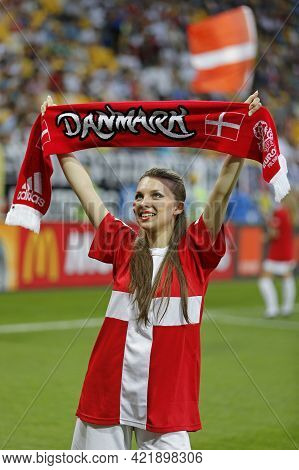 Lviv, Ukraine - June 17, 2012: Unidentified Girl With Danish Scarf Show Her Support During The Uefa