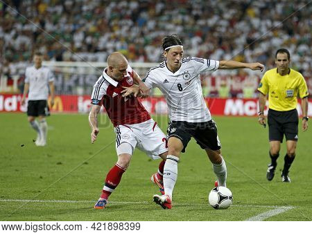 Lviv, Ukraine - June 17, 2012: Niki Zimling Of Denmark (l) Fights For A Ball With Mesut Ozil Of Germ