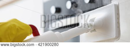 Hands In Rubber Gloves Washing Facades In Kitchen With Steamer Closeup
