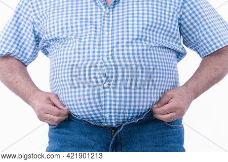 Overweight Man Trying To Fasten Too Small Clothes Isolated On White Background: Selective Focus
