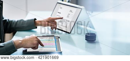Electronic Invoice Spreadsheet Software And Corporate Invoice On Computer