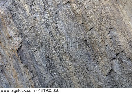 Background And Texture Of Rock Layers And Cracks In Sedimentary Rocks On A Rock In Karelia