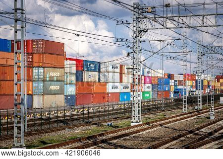 Transportation Of Goods In Containers By Rail. Container Terminal In Moscow With Many Stacked Cargo