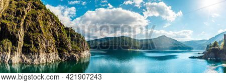 Wonderful Sunny Landscape. Mountain Lake With Perfect Sky Glowing In Sunlight. Of Vidraru Lake And D