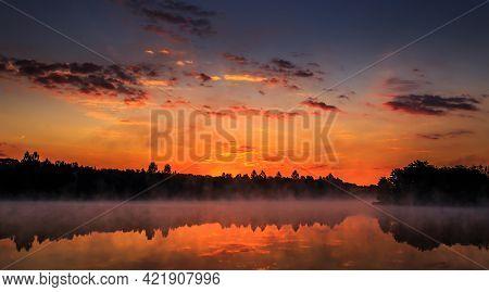 Wonderful Misty Morning. Majestic Sunrise Over The Lake. Picturesque Dramatic Scene. Creative Mage