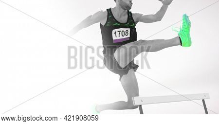 Composition of male athlete hurdle jumping with copy space on white background. sports and competition concept digitally generated image.
