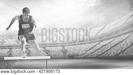 Composition of male hurdle jumper with copy space over sports stadium in black and white. sport and competition concept digitally generated image.